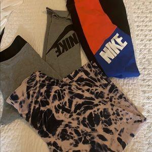 3 pairs of Nike yoga pants. Size large.